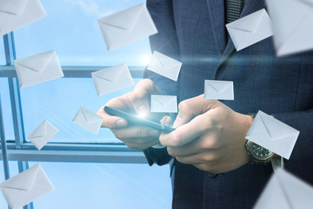 Businessman commits mailing of letters to the network on the tablet.