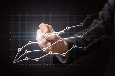 Business man draws a graph of statistics of Finance.
