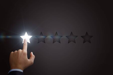 One star clicks a businessman. The concept of a negative rating.