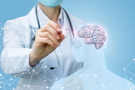 Doctor shows brain function on a blue background. Stock Photo