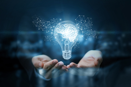Light bulb with brain inside the hands of the businessman. The concept of the business idea. 스톡 콘텐츠