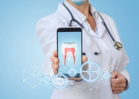 Medic in the phone app shows the treatment of the teeth on a blue background.
