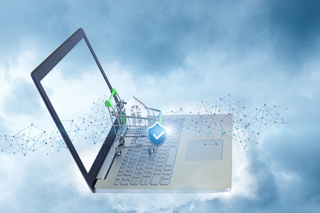 Shopping cart with a house and a shield . The concept of secure buying and selling properties. Stock Photo