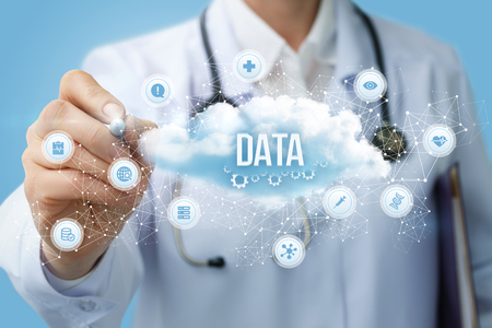 Doctor draws the structure of the data cloud on a blue background. Archivio Fotografico