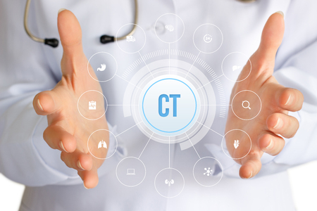 Doctor shows the icon of the Computer tomography on a blue background.