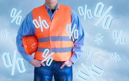 Builder is in the sky and flying percent. The concept of discounts in construction. Stock Photo
