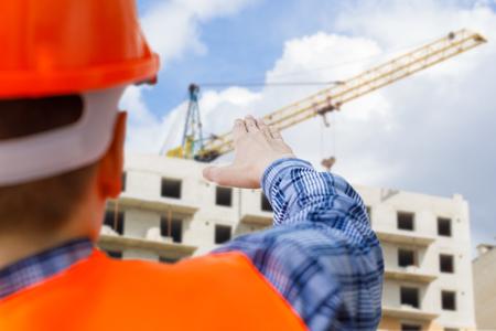 Builder manages the construction site . Concept construction.