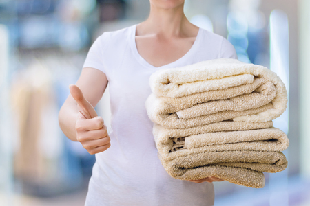 Well washed linen shows a cleaning lady on blurred background.