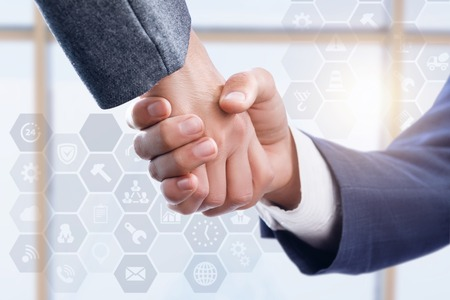 Handshake of two businessmen on blurred background. Stock Photo