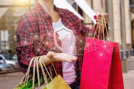 Shopper showing the symbol of protection of consumer rights.