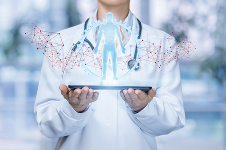 Doctor shows virtual hologram human on the tablet. Stock Photo