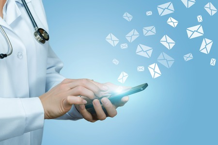Doctor works with letters in envelopes on blue background.