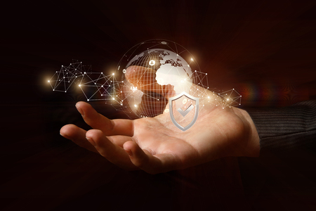 Protection of the global network in the hand on a dark background.