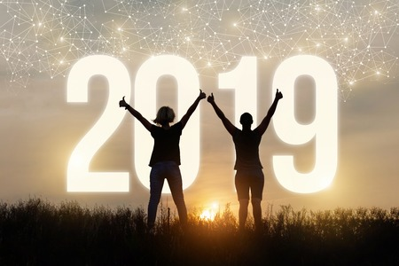 Woman show a good gesture on the background 2019.The concept of a new year.