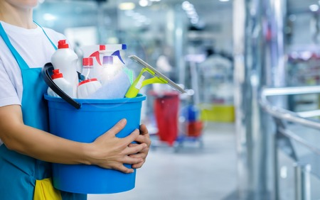 Cleaning lady with a bucket and cleaning products on blurred background. Imagens - 109197145