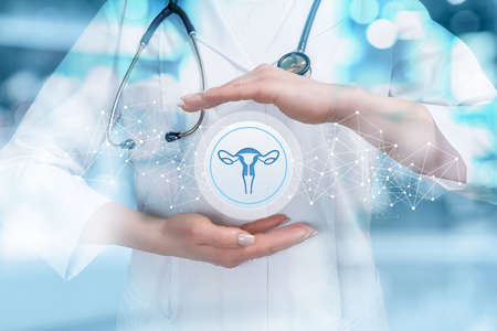 The doctor protects the uterus on a blue background.