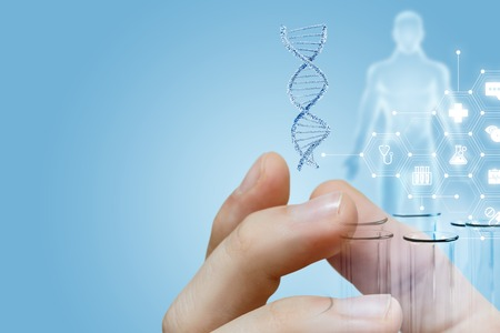 The closeup of male fingers holding a dna model and laboratory tubes with human figure image and medical service structure on the left. The concept of innovative researches. Stockfoto