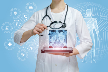 A doctor is examining digital internal organs image result above a tablet through magnifier with total medical service structure and human figure at foreground. Treatment innovative approach concept.