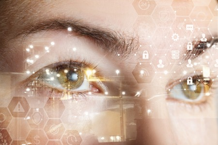 A closeup of a human female eyes with comb cyber security system structure. The concept of data and digital protection and security. Stock Photo