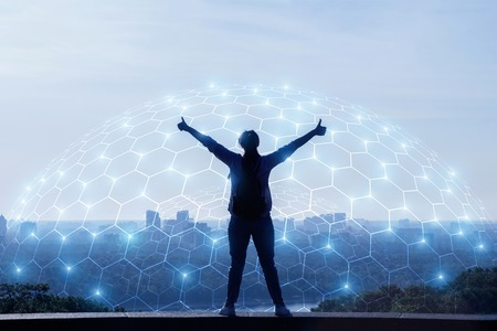 Concept of urban network connection. Woman shows the network on the background of the city.