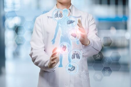 The doctor adjusts the health of the person on the blurred background.