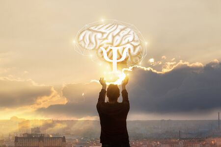 The concept of the study of the psyche . The woman reaches out to the brain with the sign of psychology.