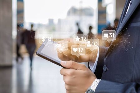 Social media network in business concept. Businessman running in the tablet.