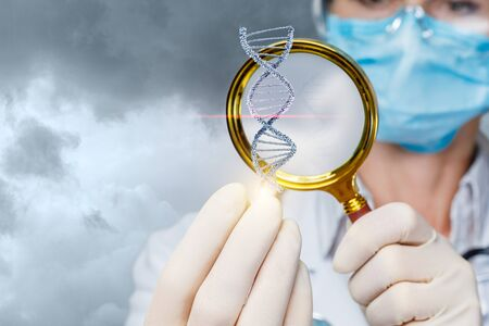 The concept study of the DNA molecule. Health worker see a DNA molecule through a magnifying glass. Banco de Imagens
