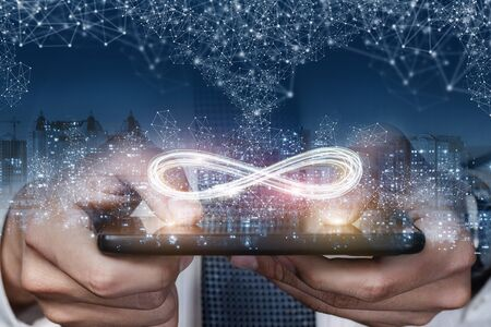 The concept of unlimited Internet. The infinity sign in the phone on the background of the city.