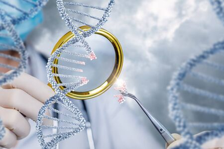 The health worker looks at DNA through a magnifying glass on a blurred background. Banco de Imagens