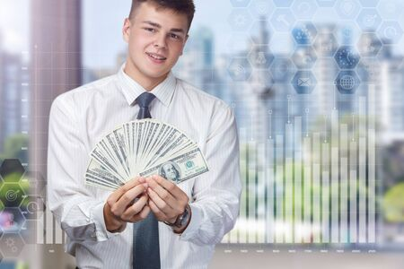Young businessman enjoys financial success against the window. Banco de Imagens