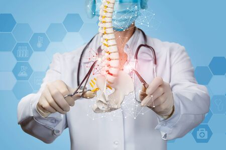 The concept of surgical treatment of the spine. Doctor produces manipulation of the spine. Banco de Imagens