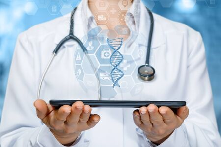 The concept of research and DNA testing. Doctor shows a DNA molecule on the tablet.
