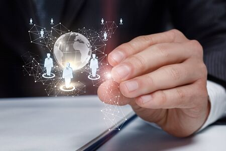 Hand shows global business team of businesspeople in the network. Banque d'images