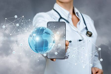 Doctor shows in the phone global medical network in the sky. Banco de Imagens