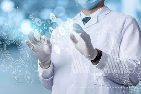 The concept of innovative information technology in medicine. Doctor works with an interface on a virtual screen.