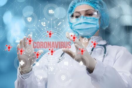 The concept of the fight against coronavirus.The doctor manipulates the inscription coronavirus.
