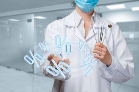 Dentist shows interest on a blurred background.