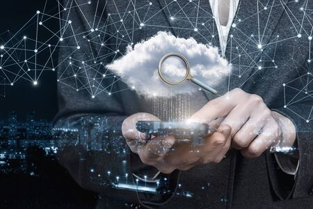 The concept of searching in the data cloud on mobile devices. Stock Photo