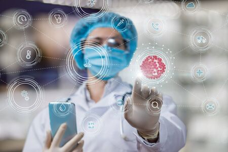 Doctor clicks on the viruses icon on a blurred background. Standard-Bild