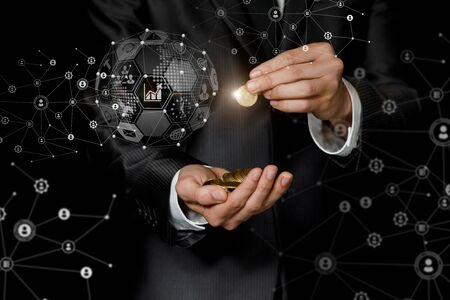 Business man holds coins in a hand on a background of a business network.
