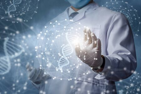 The concept of studying a DNA molecule.The doctor clicks on the DNA molecule.