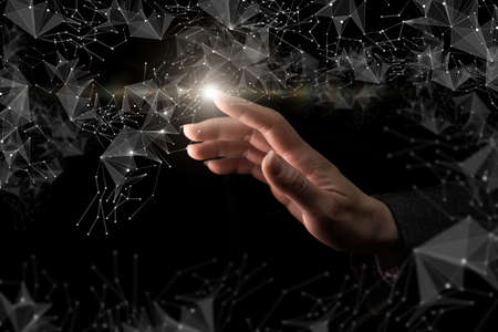 A hand clicks on a network of connections on a dark background.
