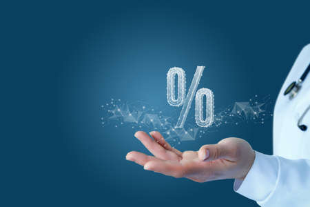 The concept of discount discounts in medicine. Doctor hand shows a hologram percent.