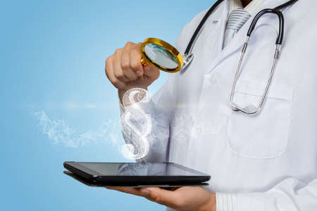 Doctor looks at a hologram of paragraph through a magnifying glass on a blurred background.