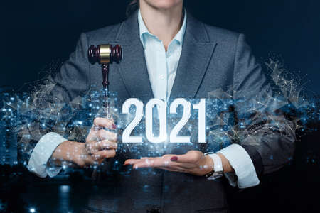 The lawyer shows the New Year 2021 in his hands on a blurred background. Stock fotó