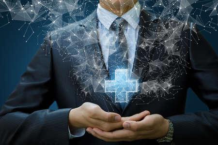 Businessman shows a hologram plus on a blue background.