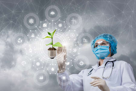 The scientist doctor clicks on the alternative plant energy icon.