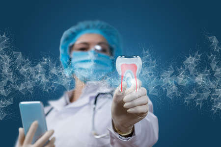 Dental treatment and prevention concepts. The dentist shows a tooth on a blue background.