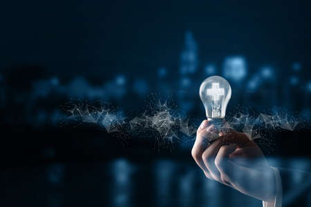 The concept of business ideas leading to profit. The hand shows a light bulb with a burning plus sign.